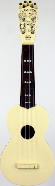 Emenee plastic Flamingo soprano ukulele with pitch pipes attached