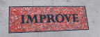 """Improve"" sign on sidewalk"