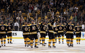 Boston Bruins players salute the fans after losing in overtime to the Capitals