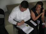 Jeff, the minister, signs the actual marriage license and certificate