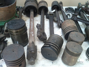 A vendor's table filled with antique engine parts