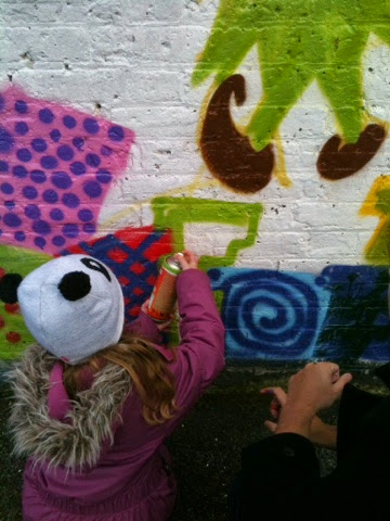 Children spray painting presents