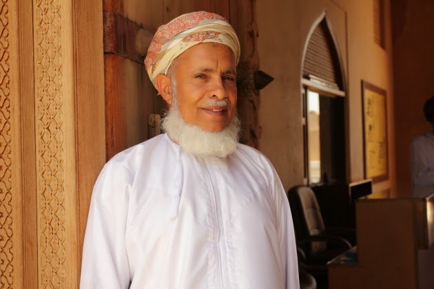 Elderly Omani Man at the entrance of Jabreen Castle, near Nizwa, Oman