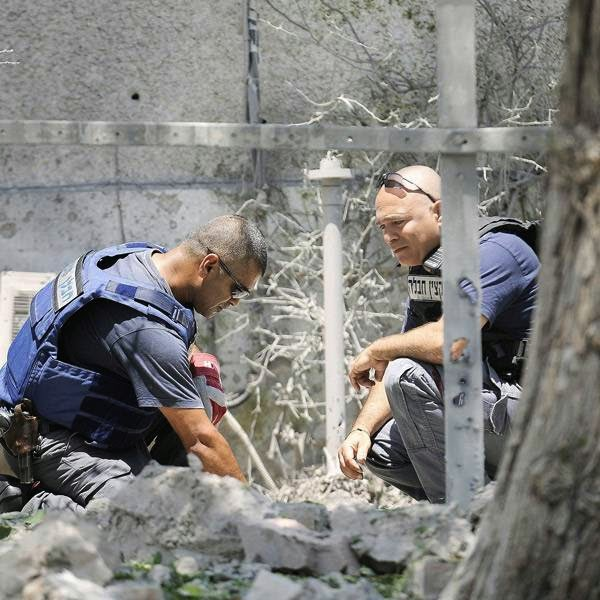 The military says three rockets were fired at empty lands near the southern Israeli city of Ashkelon. The military says they caused no casualties or damage.