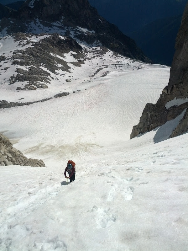 Climbing up the column to access Upper Vowell Glacier in Bugaboos