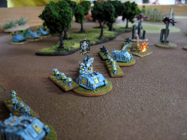 A Rune Prist leads the Grey Hunters forward.