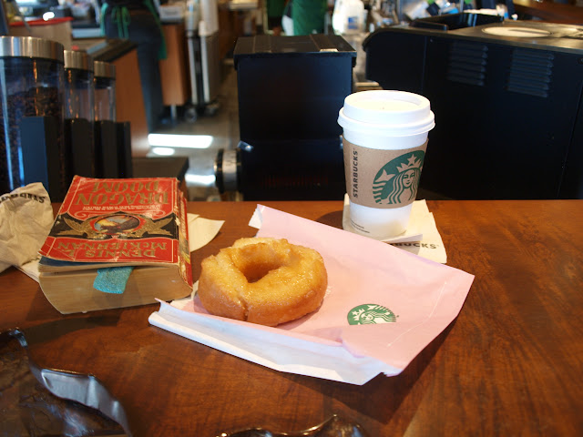 "Coffe and a ""traditional"" donut"