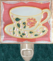 antique pink teacup and tiny pink flowers