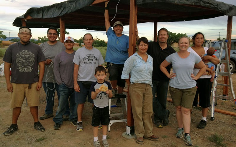 Southwest Indian Polytechnic Institute staff and volunteers displaying the newly constructed shade structure for SIPI's community garden.