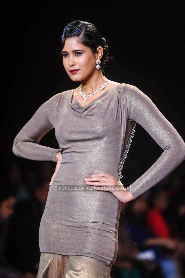 A model walks the ramp for Gitanjali on Day 2 of India International Jewellery Week (IIJW), 2014, held at Grand Hyatt, in Mumbai.<br />