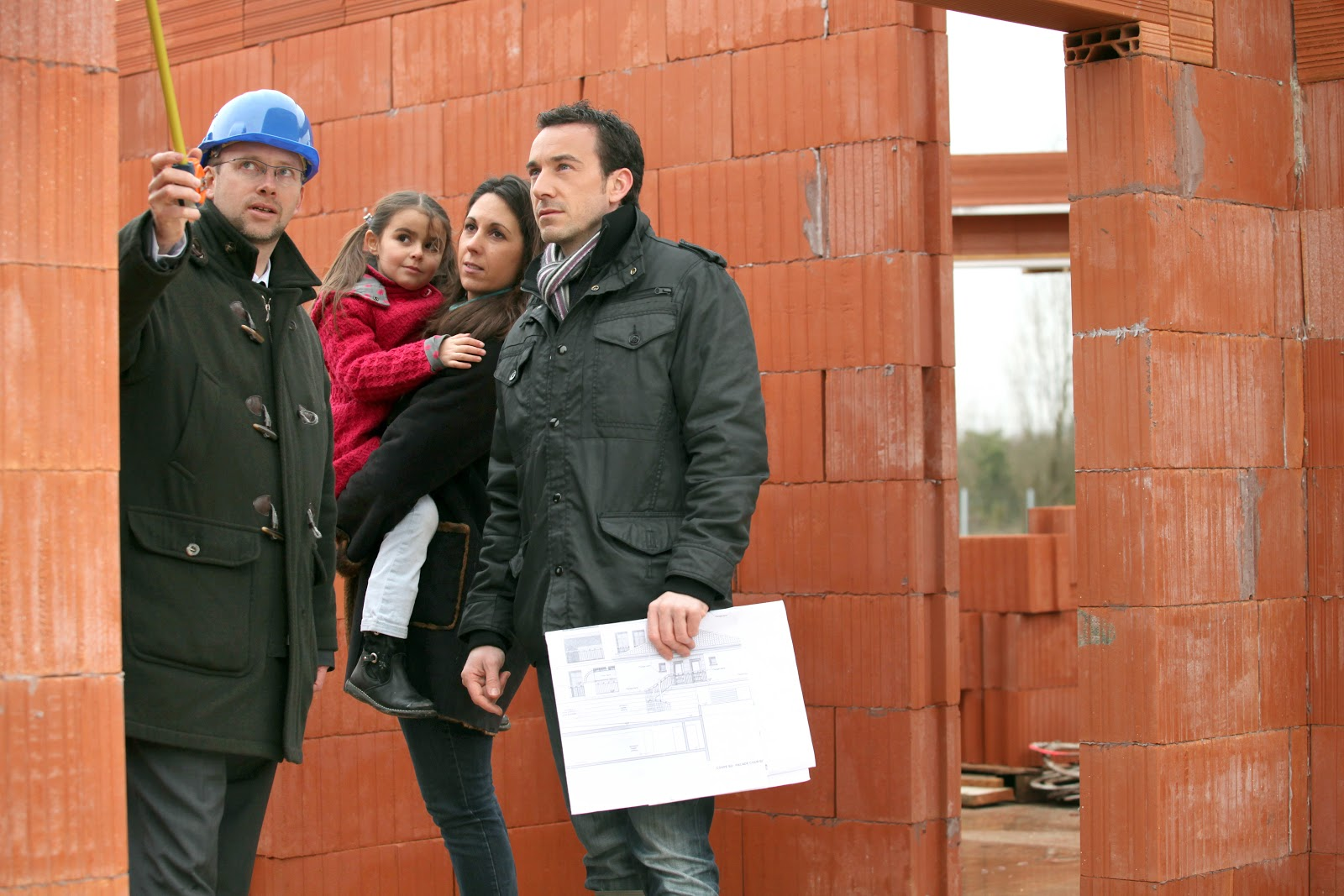 structural engineer answering a family's questions during a foundation inspection