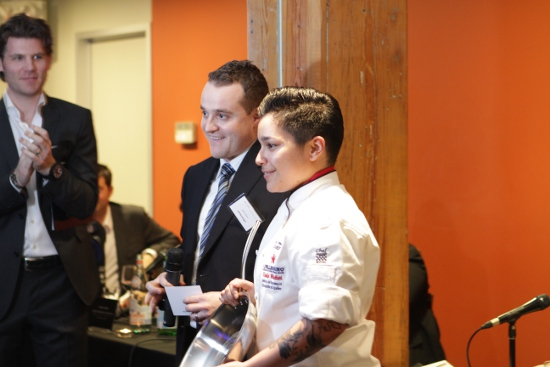 Daniela Molettieri accepts her prize as the winner of Canadian regional finals for the S. Pellegrino Almost Famous chef competition.