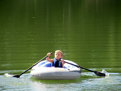Bradley paddling on the pond