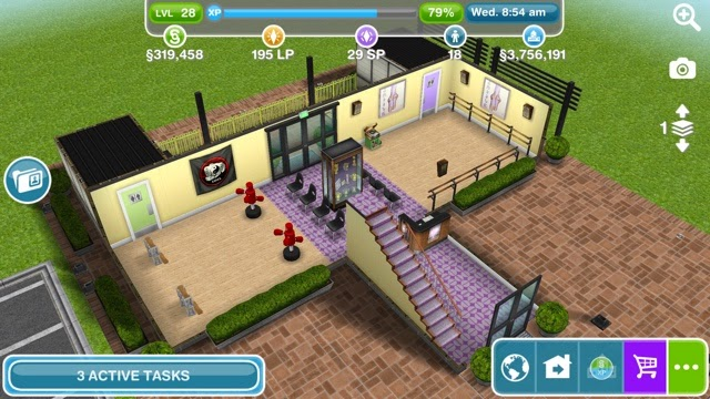 Where is the community center located on sims free play