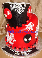 Two tier red and black fondant mad hatter style custom spiderman birthday cake design with spiderwebs