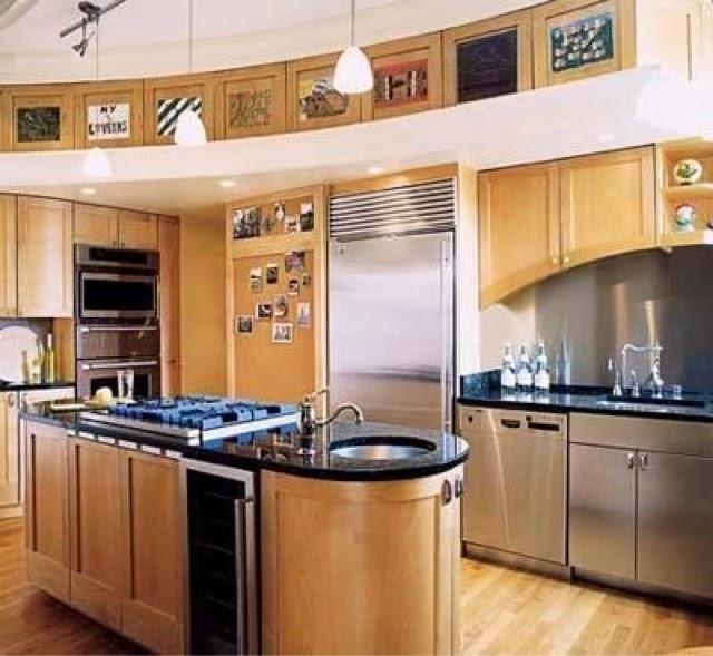 en la foto de esta cocina de ensueo cabe destacar las curvas de los muebles impactantes y como siempre con el mejor precio de cocina completa