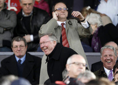 Alex Ferguson watches from the stand ahead against Bolton Wanderers