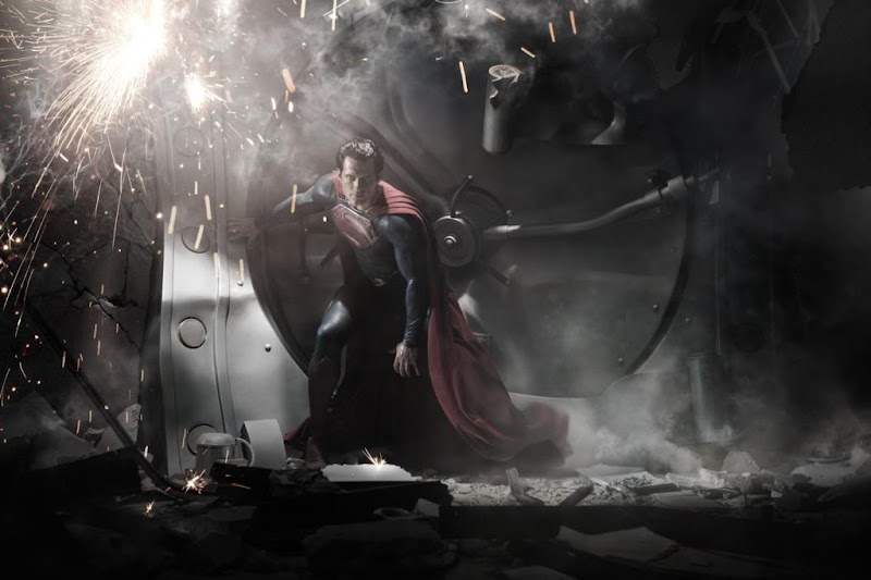 Man of Steel Superman (Henry Cavill) revealed as he smashes a bank vault (click to enlarge)