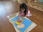 The Montessori preschool curriculum is rich in content. Here, a preschooler at the Palos Verdes campus is working on a puzzle map of Africa. During her three years in the preschool room, she'll make her own maps of all the continents, learning more geography than many children in elementary school know.