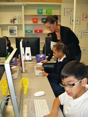 Fourth grade in the new computer lab with teacher Ms. McDonald