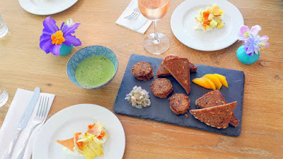 Warm Pork Rillette with oat crust, some slices of citrus, pickled shallot, and Fressen seeded rye bread at Glyph Café & Art Space