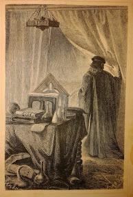 Erudito medieval con sus atributos: libros, matraces y una calavera
