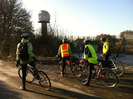 Cyclists looking at a dome on a tower