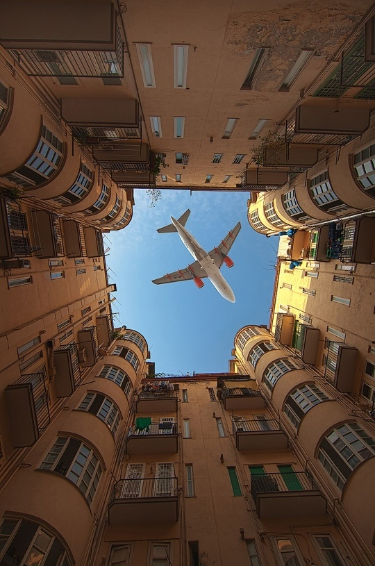 Airplane Crossing A Building