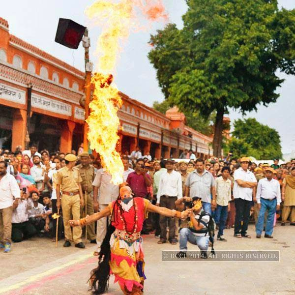 Breathing fire during Teej procession in Jaipur.