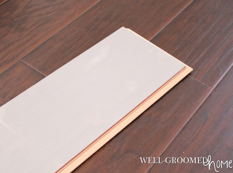 Laminate Flooring With Pad calypso salem wood laminate flooring with pad attached 65x48 inch 12mm thickness Here Is A Shot Of The Backside Of A Board Showing The Attached Pad And The Groove