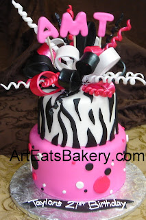Two tier pink, black and white fondant zebra and polka dot birthday cake with monogram and sugar bow