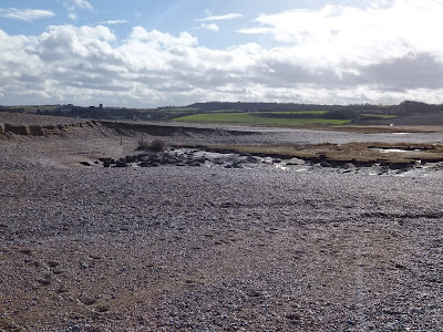 Major breach looking towards Salthouse village