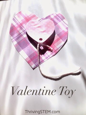 Here's a simple to make Valentine that doubles as a simple kids toy.