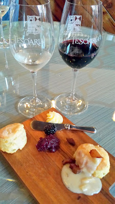 Tesoaria Portland Tasting Room January brunch: A sweet and savory duo of fresh buttermilk biscuits -the first with house prepared honey butter and blackberry dolcetto preserve. The second with thick country style gravy