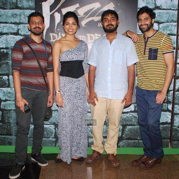 Bejoy Nambiar, Parvathy Omanakuttan, Akshay Akkineni and Akshay Oberoi pose for the photographers during the promotion of Bollywood movie Pizza 3D, held at Malad, on July 11, 2014.(Pic: Viral Bhayani)