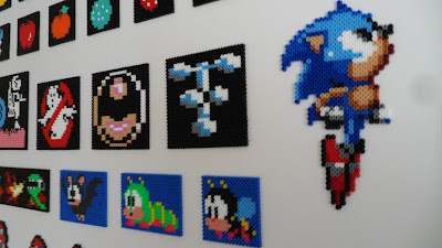 Pixel art made out of perler beads. Close up of sonic