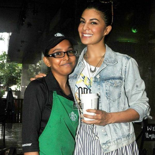 Jacqueline Fernandez poses with an employee during her visit to a coffee shop at Khar, Mumbai, on July 10, 2014.(Pic: Viral Bhayani)