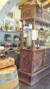 Hacienda de las Rosas huge hand-carved pinewood bar, try a flight of wine or microbrew beer