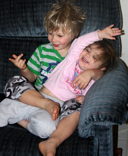 My two children share a rare sweet moment.