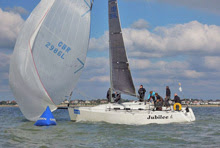 J/109 setting spinnaker at mark- sailing on Solent at Hamble Winter Series