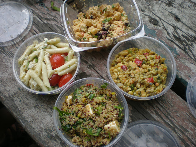 Salads cllockwise from top: spicy couscous, 7-grain, quinoa, and pasta.