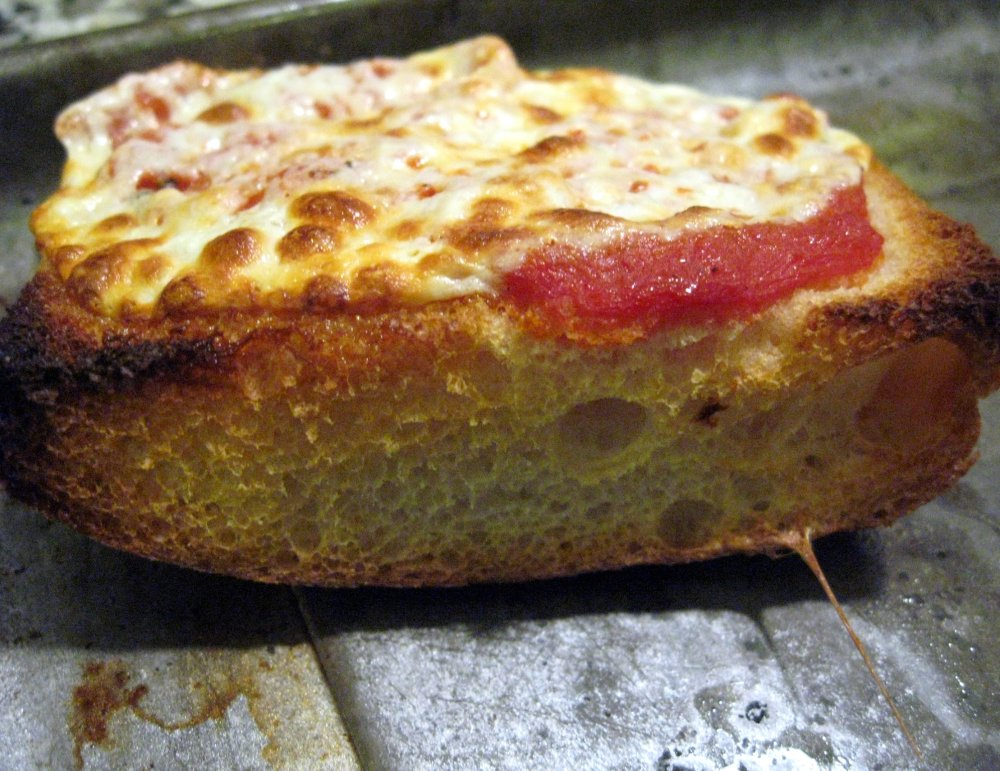 Close up of the First slice of focaccia pizza - you're looking for a combination of crispy and soft pizza characteristics