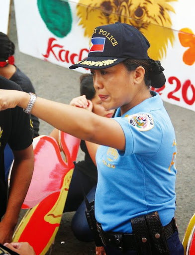 Police officer Royina Garma calls attention of photographers during Kadayawan