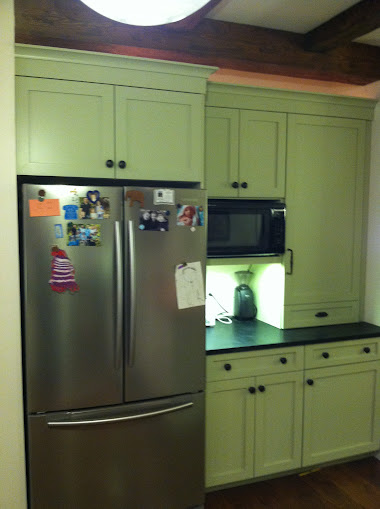 Green pantry and fridge cabinets