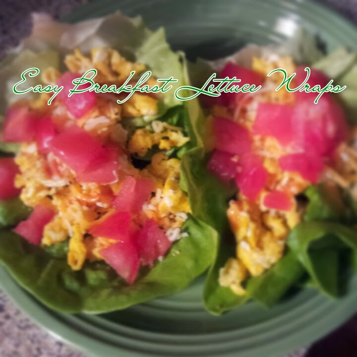Scrambled eggs smothered with chopped tomatoes and shredded cheese in lettuce leave. A deliciously healthy way to get some protein into your diet. So simple and easy!