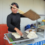Grilling sticky rice cakes in Lembang, a hilly resort area outside of Bandung...