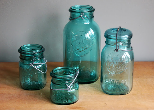 Teal mason jars available for rent from www.momentarilyyours.com, starting at $0.50 each.