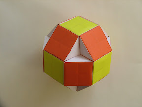 "Rhombicuboctahedron from Square Module Flat Units in ""3-D Geometric Origami: Modular Polyhedra"" by Gurkewitz and Arnstein."