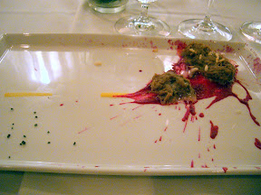 Homaru Cantu dish of Roadkill of Fowl which is a braised duck with beets. Notice the yellow dotted lines of the road and rice krispy maggots