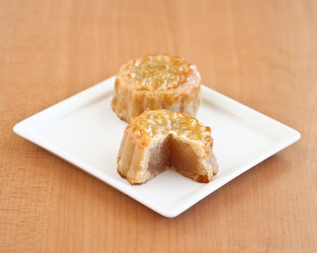 photo of two mooncakes on a plate